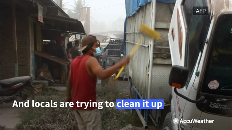 Residents remove ash and debris after volcanic eruption