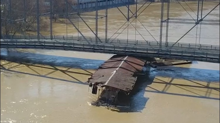 Flooding causes loose marina to slam into bridge