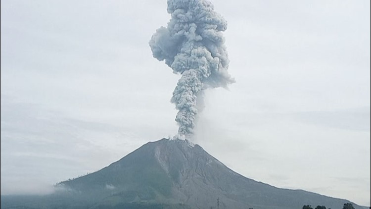 Indonesian volcano spews ash and debris