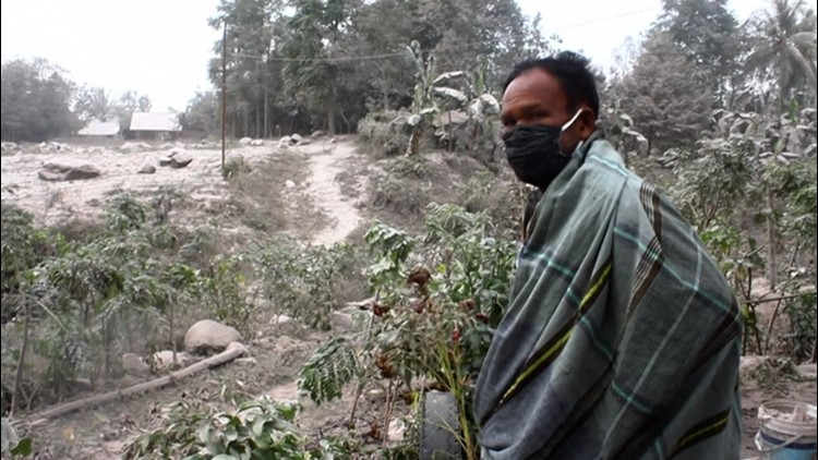 Residents start long cleanup as Mount Sinabung coats farms with ash