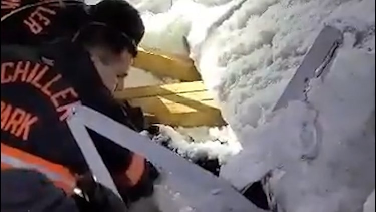 Woman rescued after awning collapses due to snow and ice