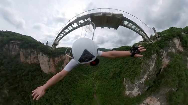 Must See! Daredevils Bungee Jump Off the World's Tallest Glass-Bottomed Footbridge