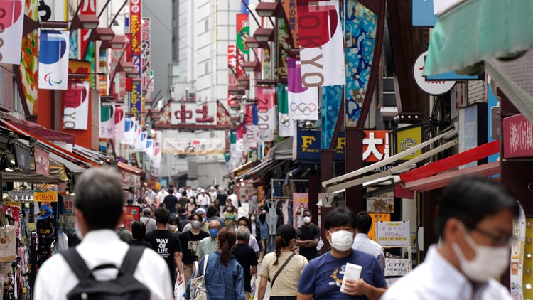 Japan expands virus emergency after record spikes amid Games