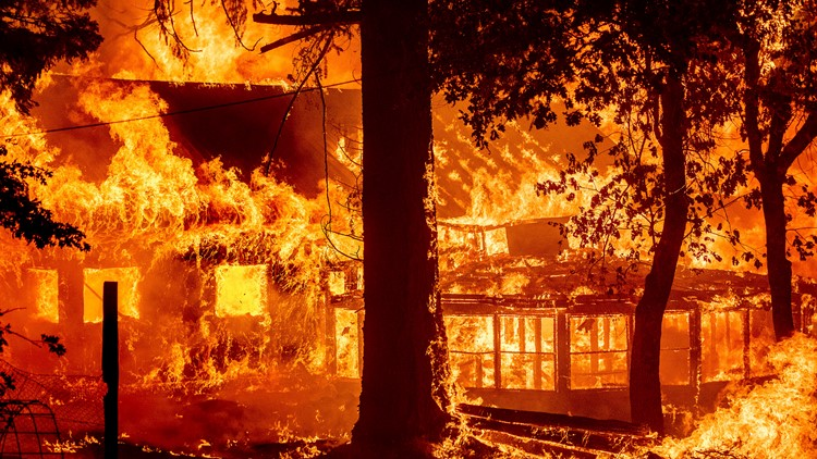 California's largest fire burns homes as blazes scorch West