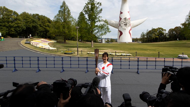 Olympic torch runs through empty park in Osaka as COVID cases rise