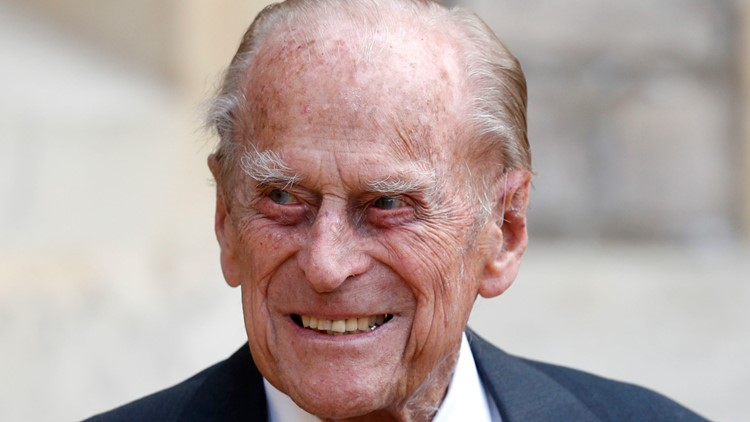 Prince William says hospitalized grandfather Prince Philip is 'OK'