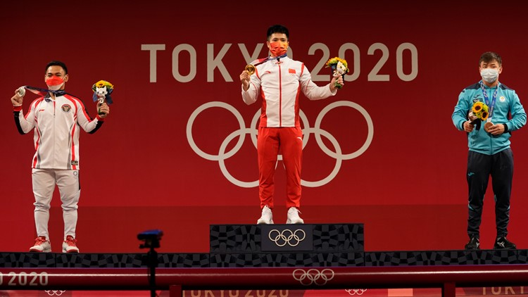 IOC relaxes mask rules for medalists