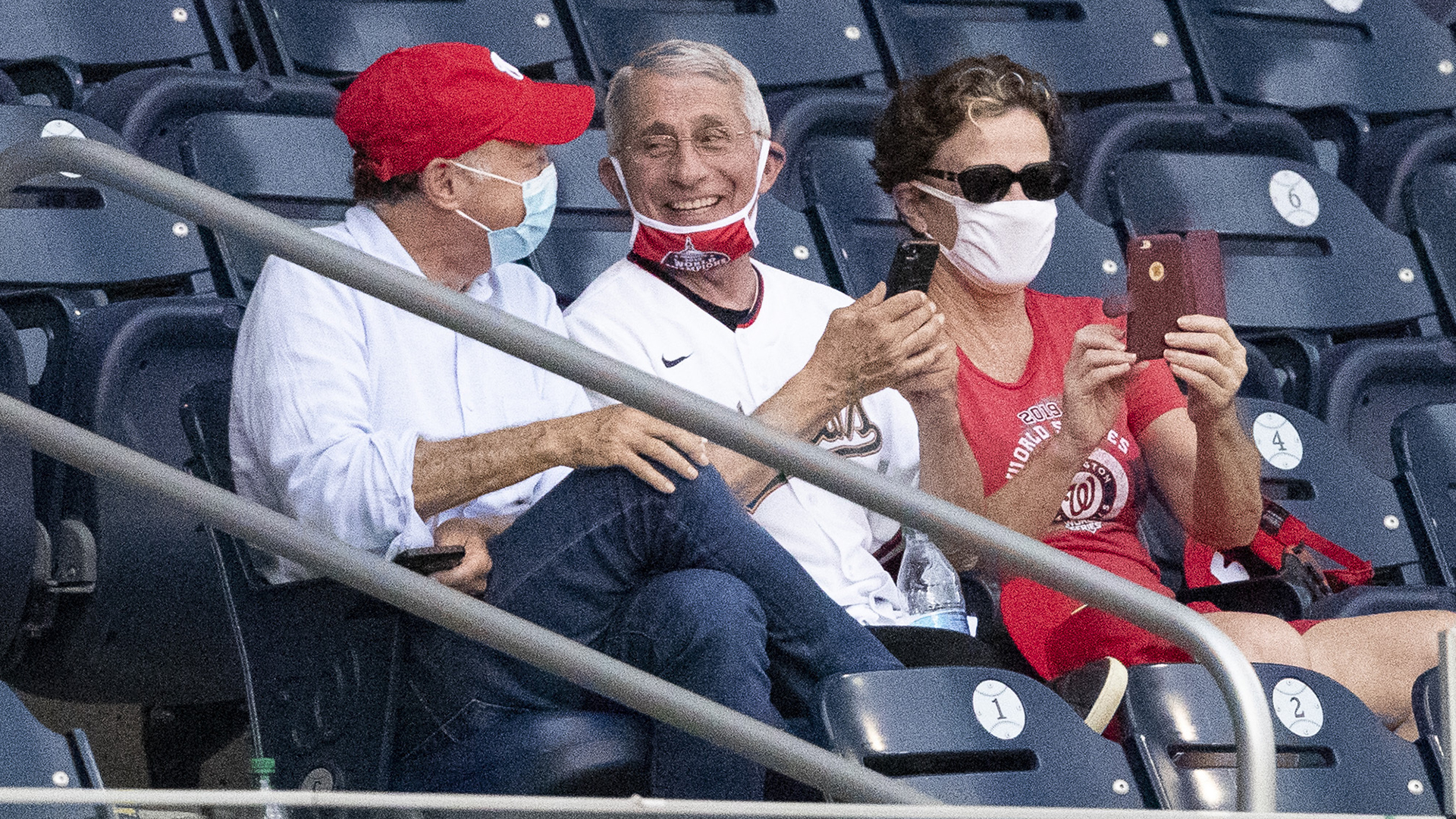 Photo of Fauci with face mask down draws jeers. He fires back. | wusa9.com