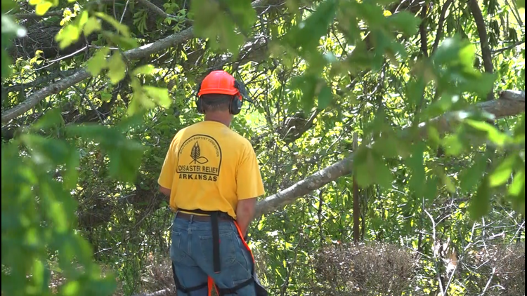 Arkansas Baptist Disaster Relief volunteers helping clean up following tornados