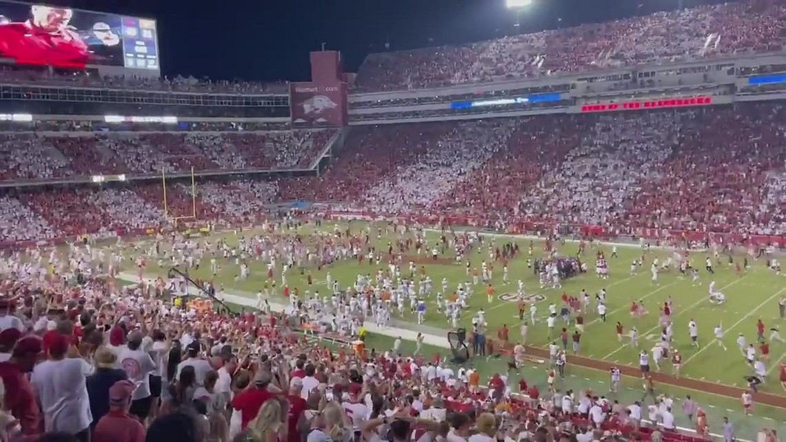 Razorback fans storm the field after historic win over #15 Texas