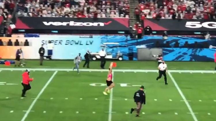 Fan on the field interrupts Super Bowl