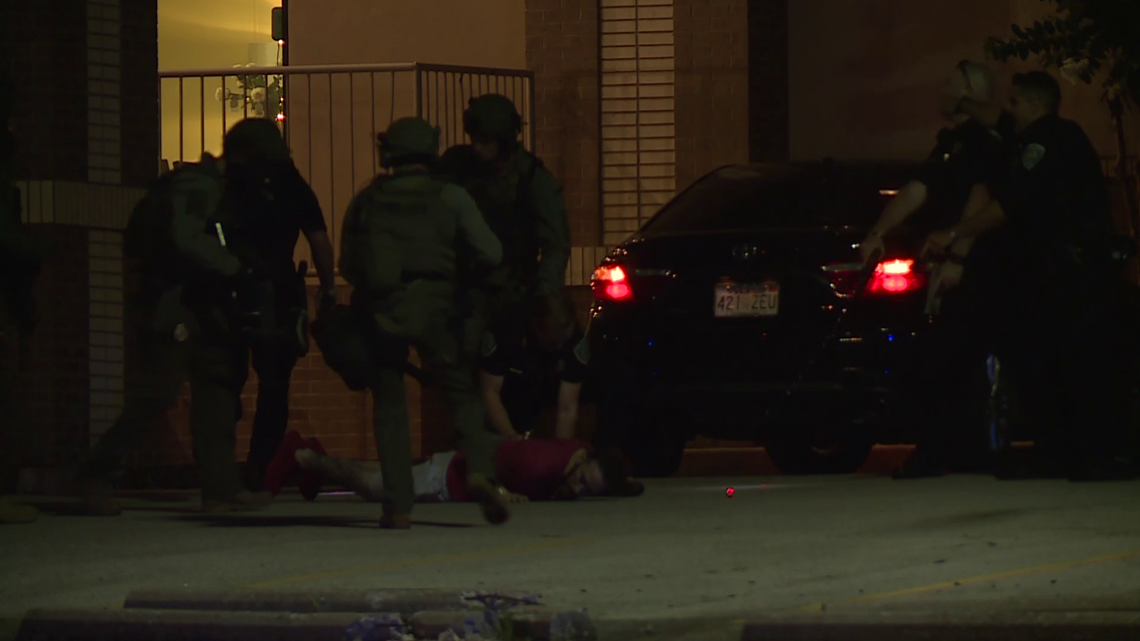 Lengthy standoff ends with police shooting a former officer in Fayetteville