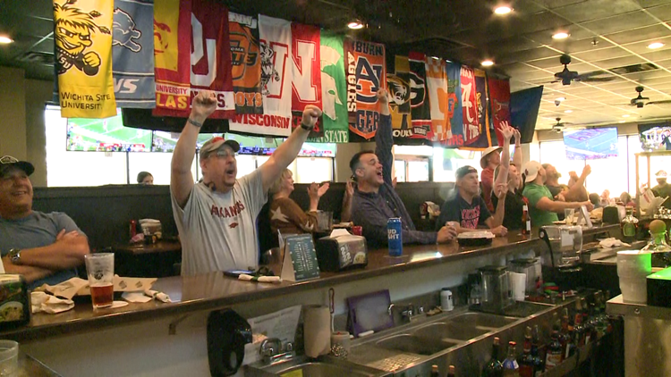 Fans flock to local businesses to watch the Hogs defeat Aggies in Arlington