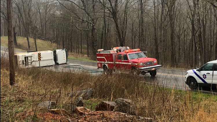 Garbage truck rolls over in rural Madison County, blocking highway