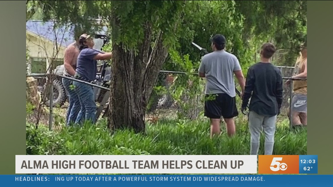 Alma Football players help community cleanup storm aftermath