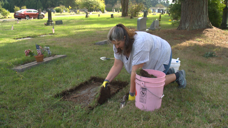 Woman cleaning hundreds of gravestones at Washington cemetery