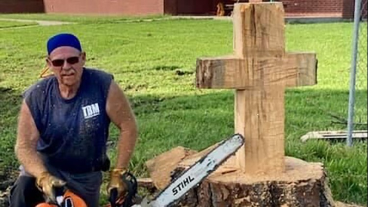 'Constant reminder of God's love' | Volunteer carves cross from tree downed by Hurricane Laura