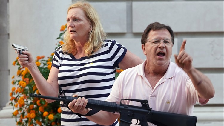 Governor pardons St. Louis couple of charges related to pointing guns at protesters