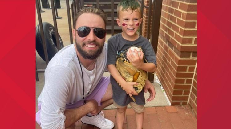 Razorback super fan meets his hero, Casey Opitz