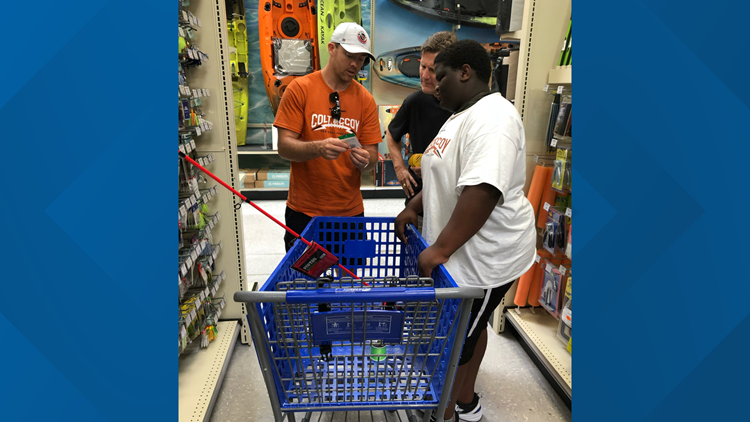 Former Texas Longhorn Colt McCoy helps kids with Father's Day shopping spree