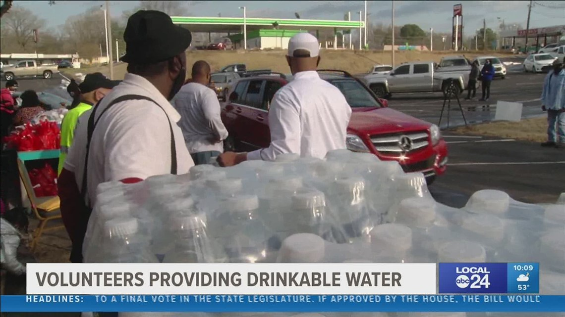 Free water distribution event gives people hope that we can get through this as a community