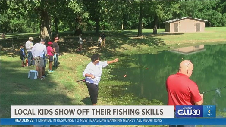 Kids had fun outside fishing with their parents