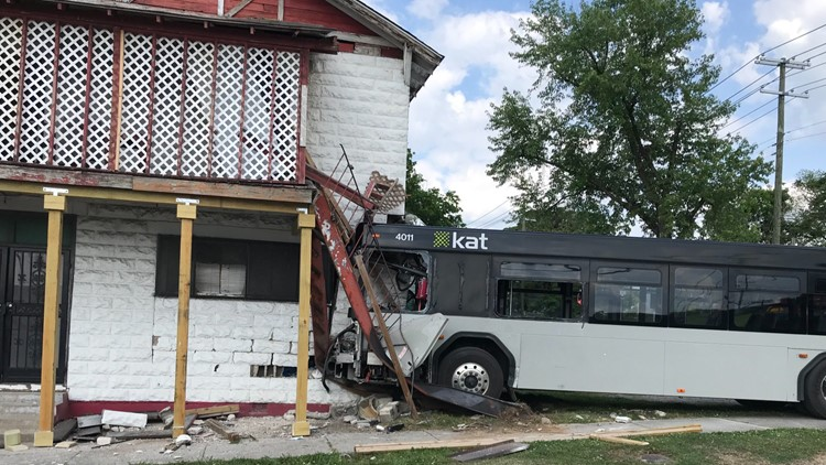 Footage shows KAT bus crashing into building after collision with FedEx truck