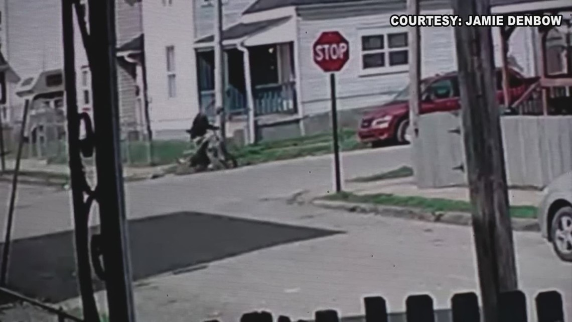 Surveillance video shows 9-year-old caught in crossfire between two suspects