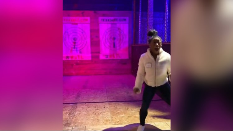 Watch Simone Biles master the art of axe throwing, perfectly hitting the bullseye