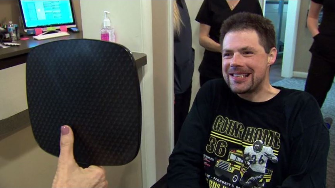 Man who overcame drug addiction finds his smile again after getting life-changing dental implants