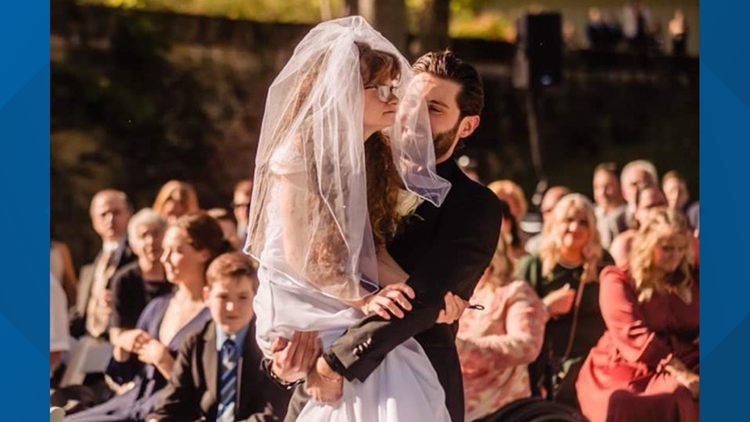 A couple's wedding day goes viral after groom carries sister-in-law down the aisle
