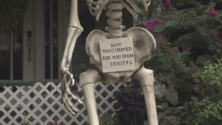 'See you soon, idiots': Man puts 13-foot skeleton in his yard to encourage vaccinations