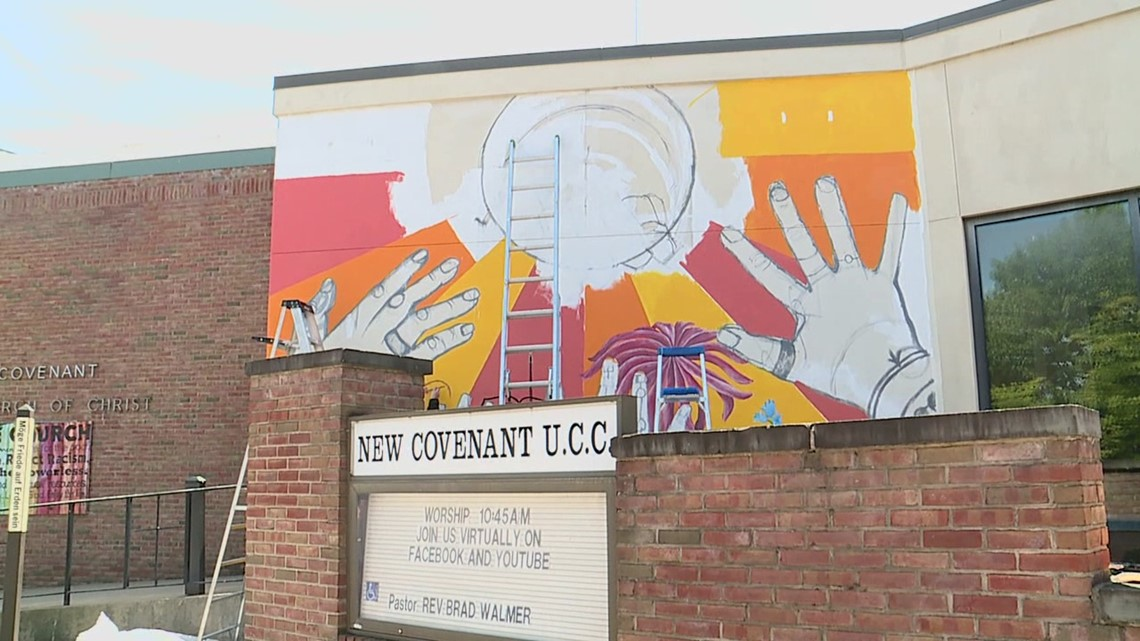 Students paint mural with message of equality
