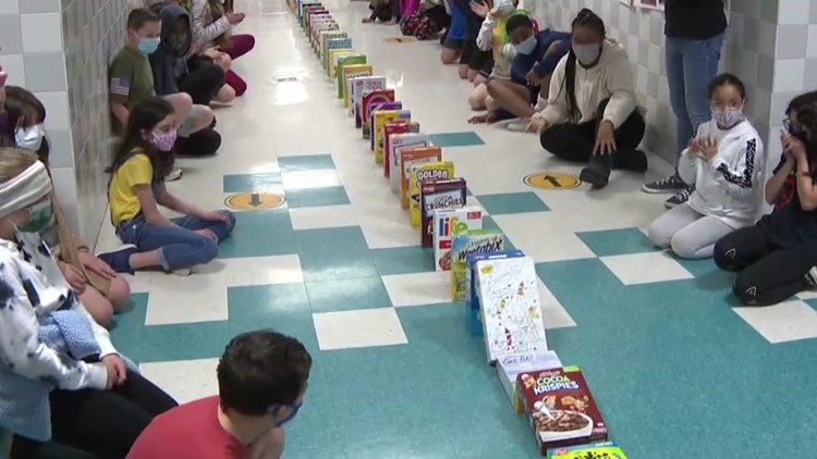 Students get a lesson in the domino effect