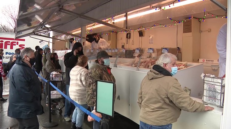 Busy day at seafood markets on Christmas Eve as people prepare to celebrate Feast of Seven Fishes