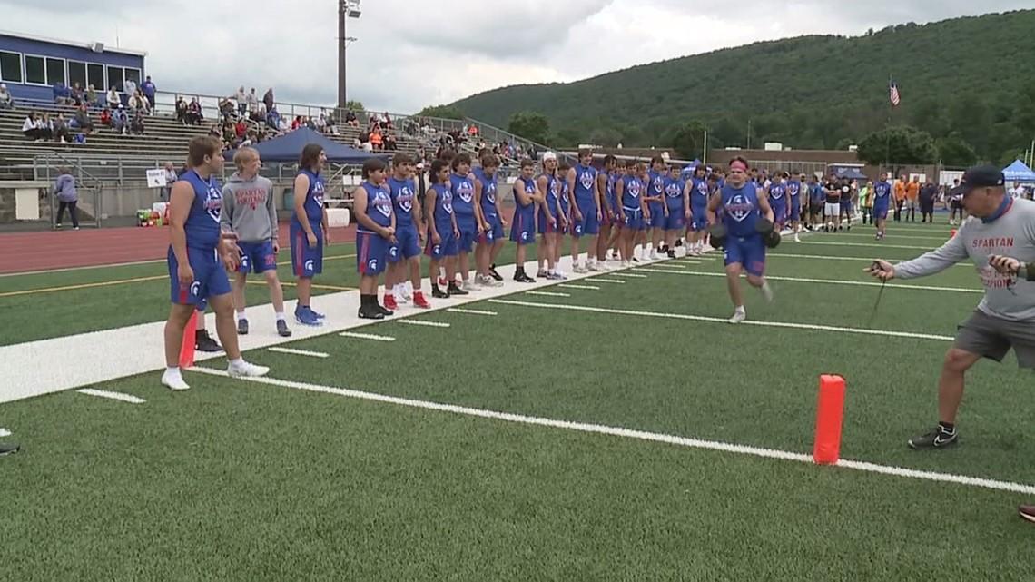 High school football challenge raises money for pantry program