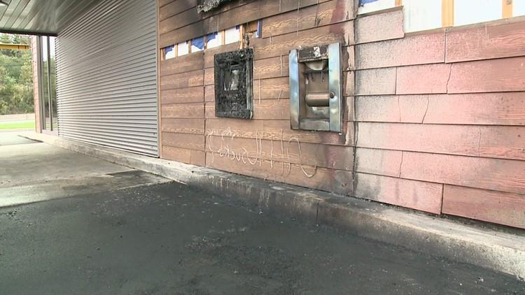 Car fire damages bank drive-thru