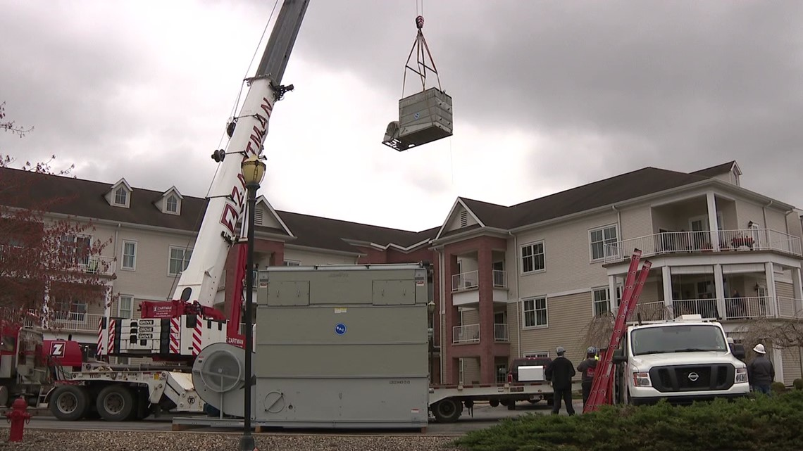 Crane used to repace cooling unit, seniors get front-row seat