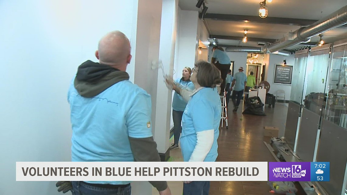 Volunteers in blue help Pittston rebuild