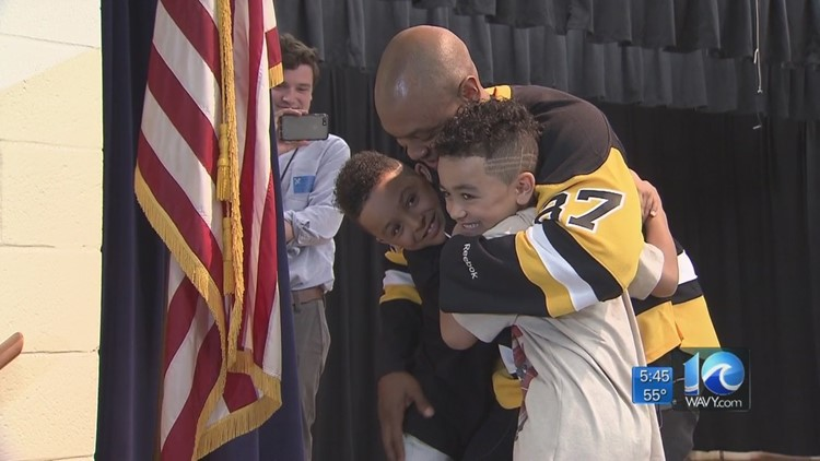 Home at last! Marine surprises sons at their school