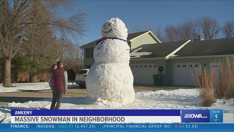 Ankeny family succeeds in building giant snowman in their front yard