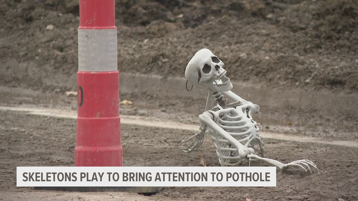 Fishing skeletons: Indianola woman's hopes to bring attention to huge pothole with spooky display