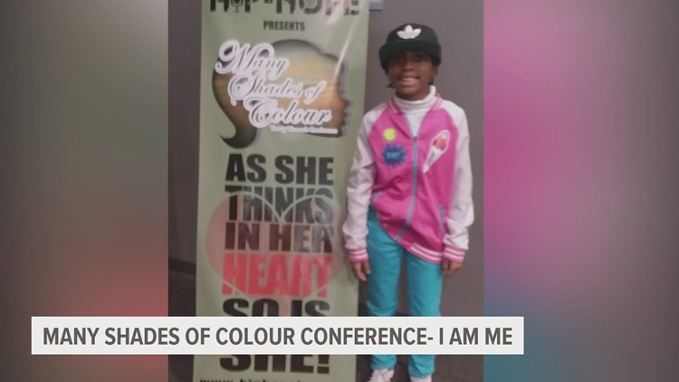 Young women lifting up their voices at the 2021 Many Shades of Colour conference