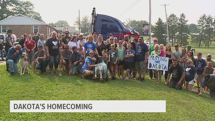 Community turns out to welcome home boy fighting brain tumor