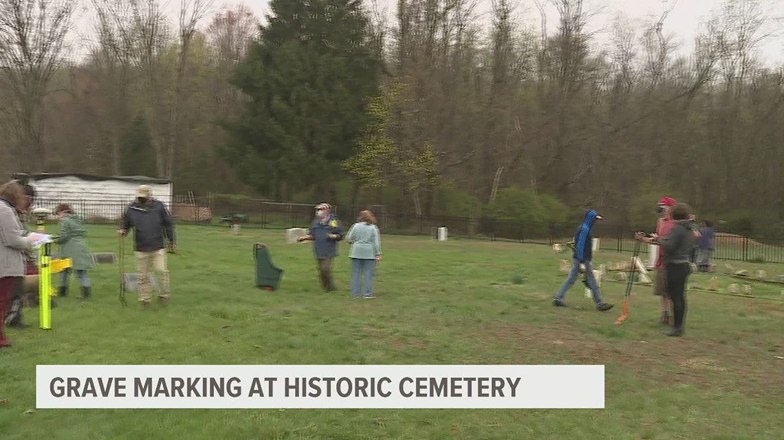 Mt. Tabor Preservation Project placing solar lights on unmarked graves at Cedar Street Cemetery