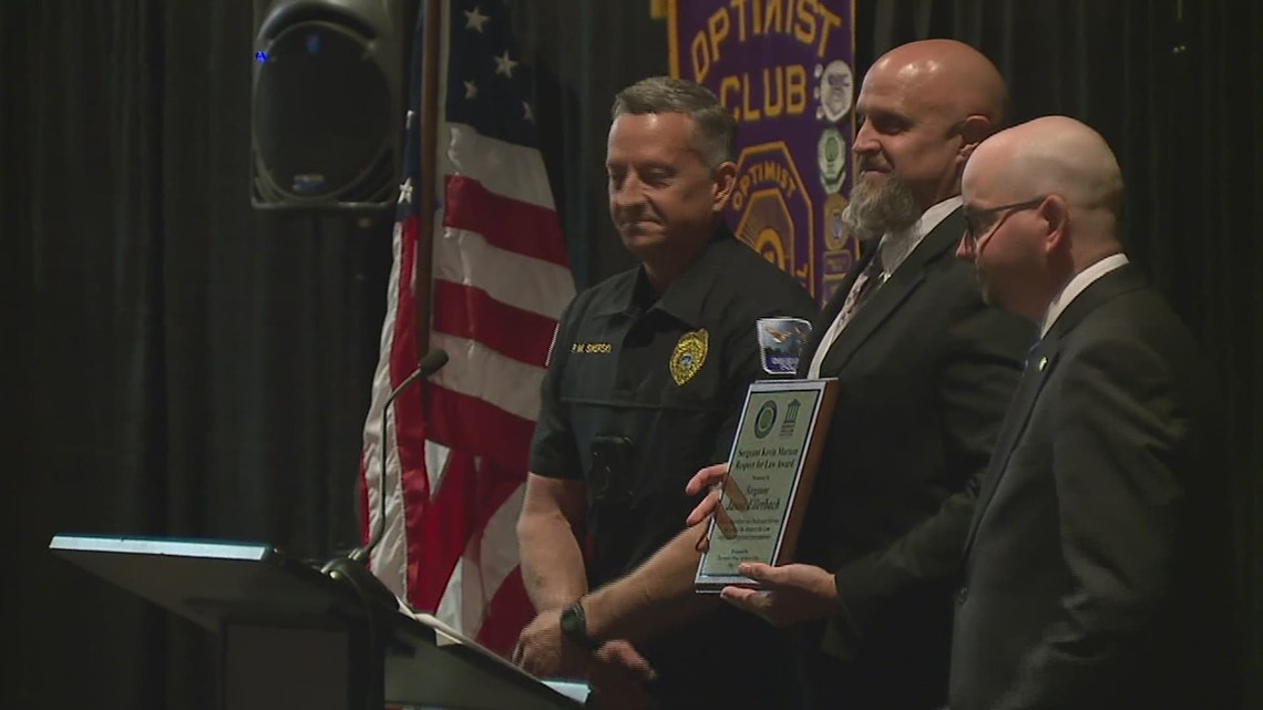 Davenport Noon Optimist Club honors DPD sergeant for long career and dedication