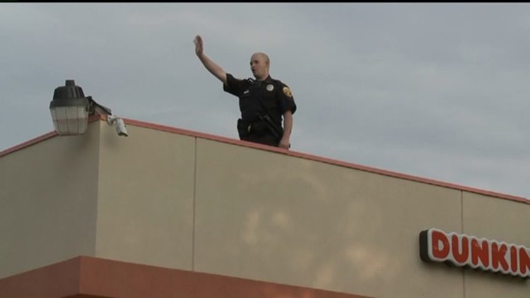 Want To See A Cop On A Roof Drive By Dunkin Donuts Friday Wqad Com