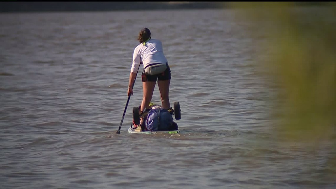 Woman Paddleboarding the Mississippi