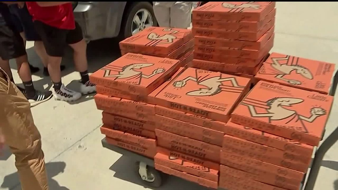 High school grad throw pizza party for homeless