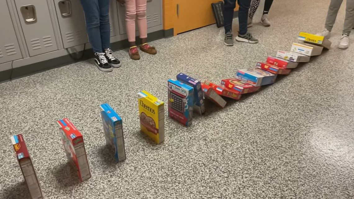 Elementary students collecting cereal boxes for STEM project and charity